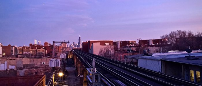 CTA train stop at the Blue line station on Western (Photo © Henry Del Rosario)